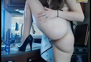 Beauty webcam girl in the kitchen