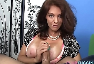 Handjob loving MILF makes cock happy in POV
