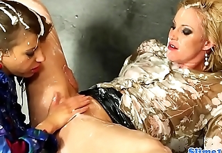 Cumdrenched euro lesbians fist each other