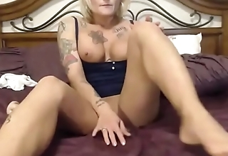 Inked bodybuilder MILF with perfect big tits