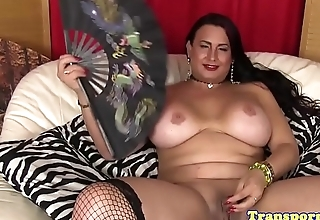 Busty tranny pornstar in stockings tugs cock
