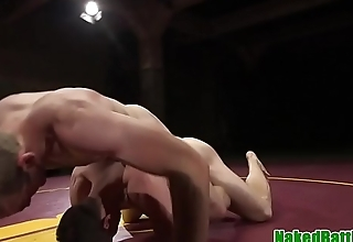 Wrestling stud punished with cock in mouth