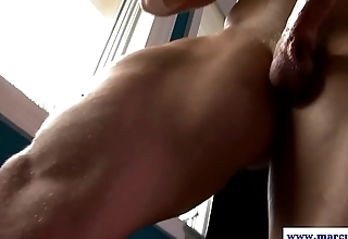 Buff jock jerks cock before cuming on window