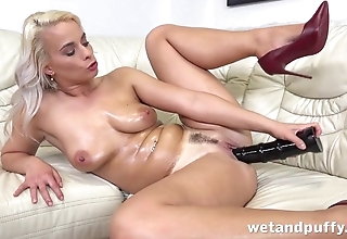 Tanned blonde cums from huge black dildo in pussy