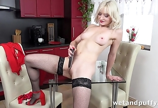Sexy blonde in stockings pleases herself with dildo