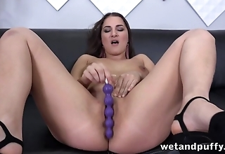 Dazzling MILF sticks sex toys into pussy during solo