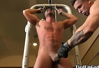 Muscular stud flogged by ripped maledom