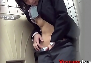 Asian babe rubs in public